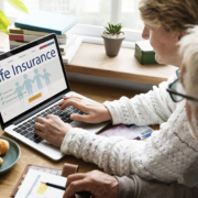 couple looking up life insurance on a laptop